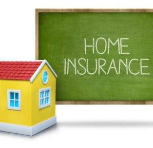 Home insurance text on blackboard with 3d house
